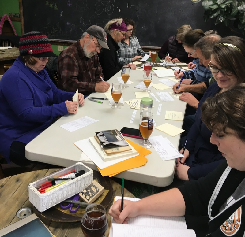 Writing postcards to electors at Imagine Nation Brewing.